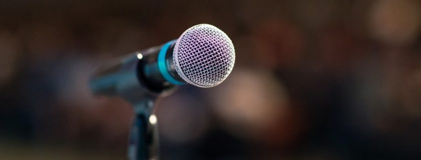 an image of a microphone before someone does a speech