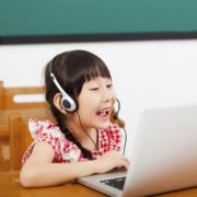 a bilingual child at home on a laptop