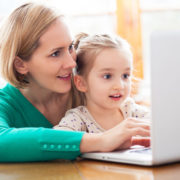mother and daughter doing online speech therapy