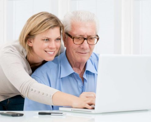 online parkinsons speech therapy for a man at his computer