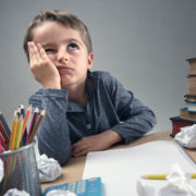 a bored child showing symptoms of an expressive language disorder