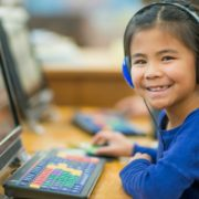 girl with a speech disorder on a computer