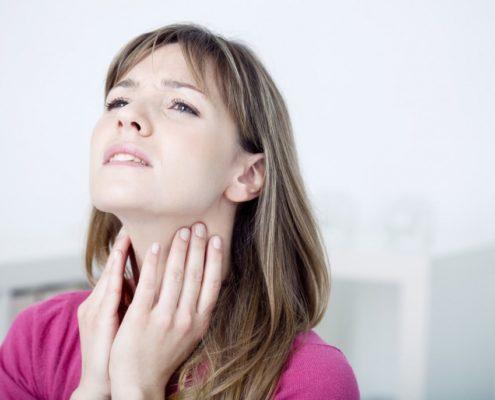 woman massaging her vocal nodules