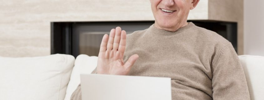 a man with Alzheimer's doing online speech therapy