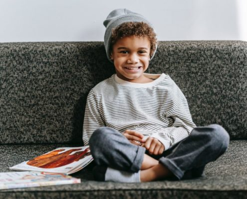child sitting on a couch