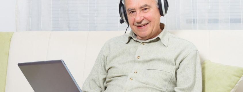 a stroke victim at home on a laptop getting help