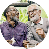 Two older man talking and laughing representing Reclaim lost skills, quality of life, or independence.