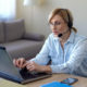 a woman using online speech therapy at home for brain injury recovery
