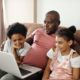 a family on a home computer with questions about speech therapy