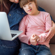 a child at home working on her communication skills through online learning