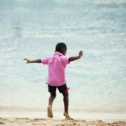 a child at the beach doing speech therapy during the holidays