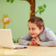 a boy with Asperger's syndrome at home doing online speech therapy