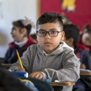 a child with a speech disorder at his desk at school