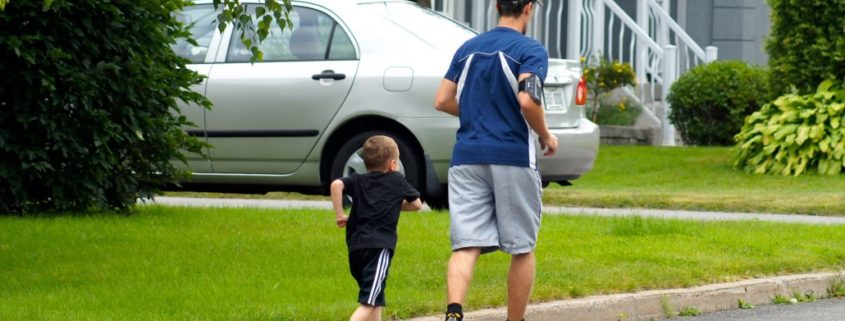 father and son communicating while jogging