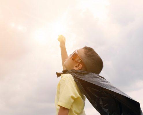 child dresses as a superhero