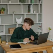 man doing online speech therapy for the th sound