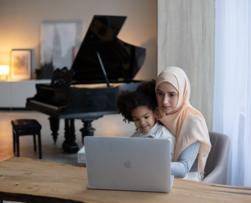 a mother and daughter on a screen together