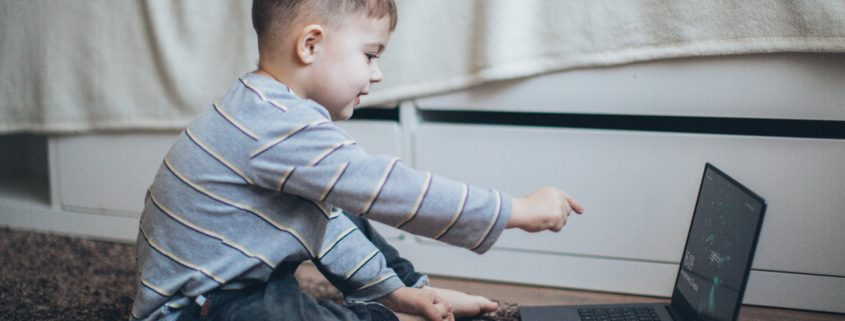 a child learning at a computer