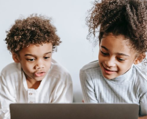 two children doing online speech therapy