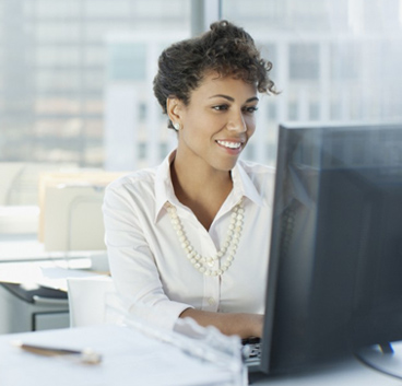 business woman smiling while looking to notebook