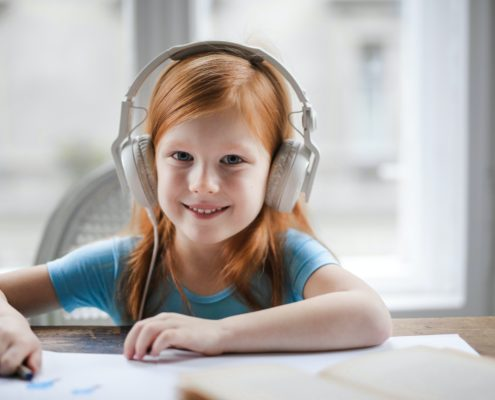A child at home doing PROMPT therapy on her laptop